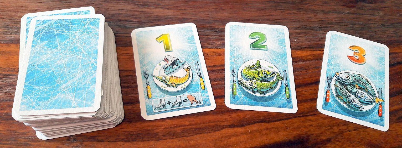 Les cartes rapportent de 1 à 3 poissons et serviront à compter les points entre les manches et à déterminer le vainqueur en fin de partie.
