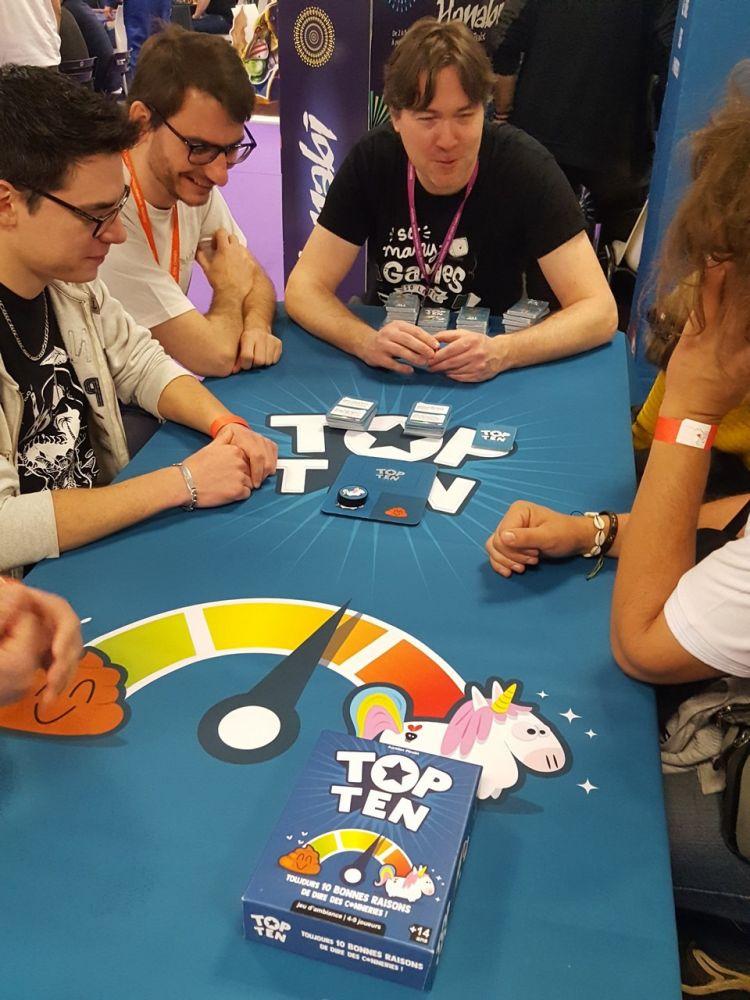 On continue notre visite des stands chez Cocktail Games pour essayer Top Ten leur nouveau jeu 'ambiance. C'est excellent mais le prix annoncé de 22€ à la sortie nous refroidit un peu !