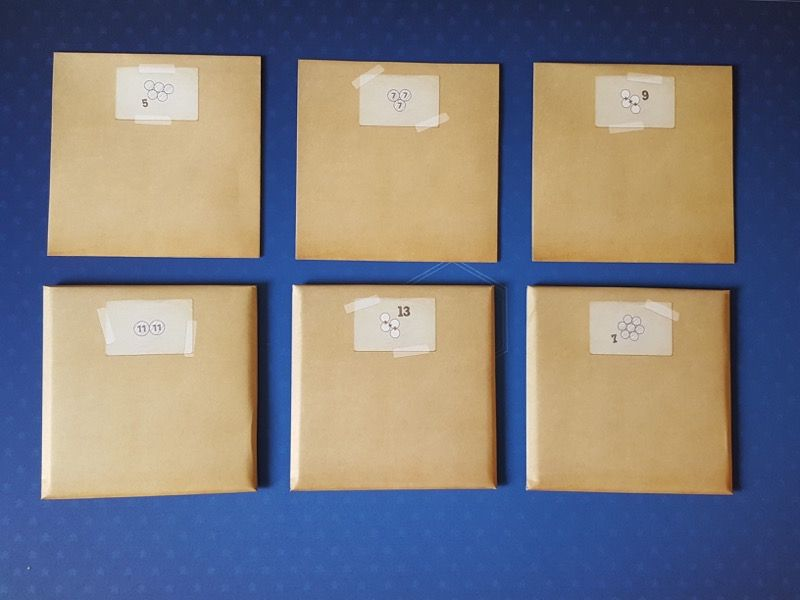 Les 6 enveloppes Challenge du mode aventure dont 3  bien épaisses toutes cachetées !