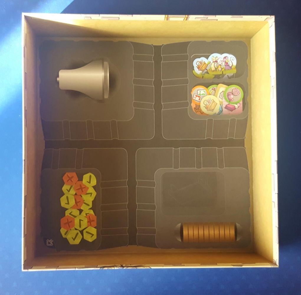 L'intérieur de la boite avec un rappel des dessins du matériel qui servira à bien installer la maison.