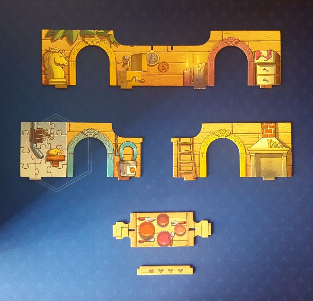 Le grand mur central et les 2 petits murs latéraux  avec une table à manger le tout en carton bien épais.