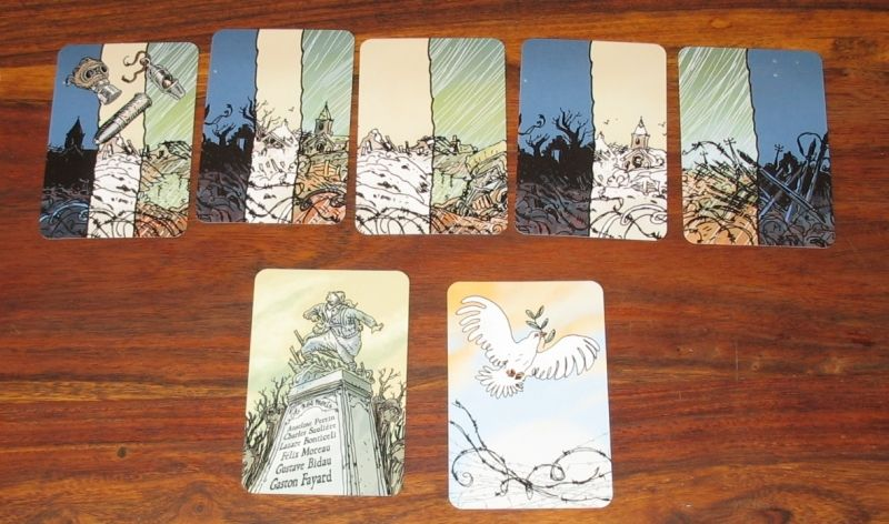 Les cartes menaces multiples temps, la colombe de la paix (objectif du jeu) et le monument au mort (la défaite...)