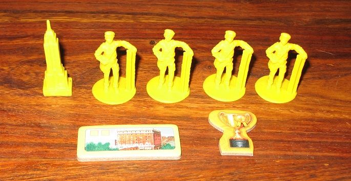 En plus des gratte-ciels chaque joueur a également 1 pion marqueur (gratte-ciel), 4 ouvriers, 1 bâtiment de départ et un jeton King.