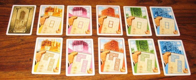 65 cartes terrains (de 2 ou 3 cases) en 5 couleurs (pour chaque district)  correspondant à tous les terrains de New York.
