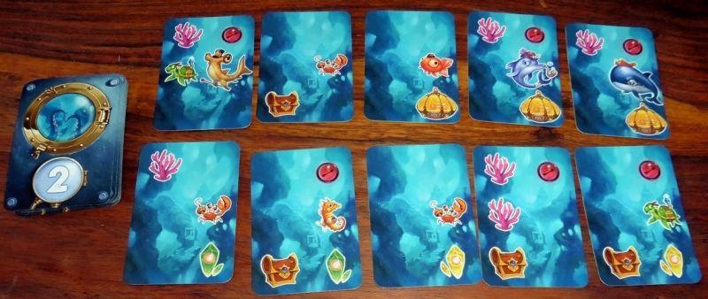 Chaque carte exploration comporte des poissons, des cristaux, du corail...