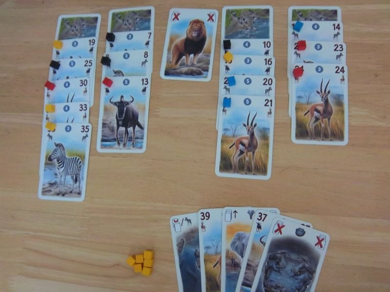 Vous avez la main de cartes du joueur jaune. C'est votre tour... que jouez-vous ?